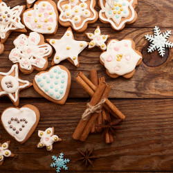 Christmas cookies on brown wooden background. Top view